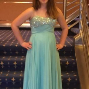 Gorgeous beaded aqua colored strapless gown.